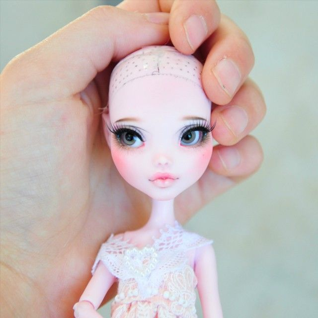 This is how she turned out! I'm really thrilled with the idea that's she like a little bjd now! 😍 but I think I'm going to redo her faceup, the left side looks a bit messy, and its throwing me off a bit. But I'm still super happy with her! :-D what do you guys think? ALSO: putting eyes in monster high is the hardest thing you'll ever do. Took me 20 minutes min. #monsterhigh #monsterhighdoll #doll #mh #mod #culur #culurfaceups #faceupartist #repaint #draculaura