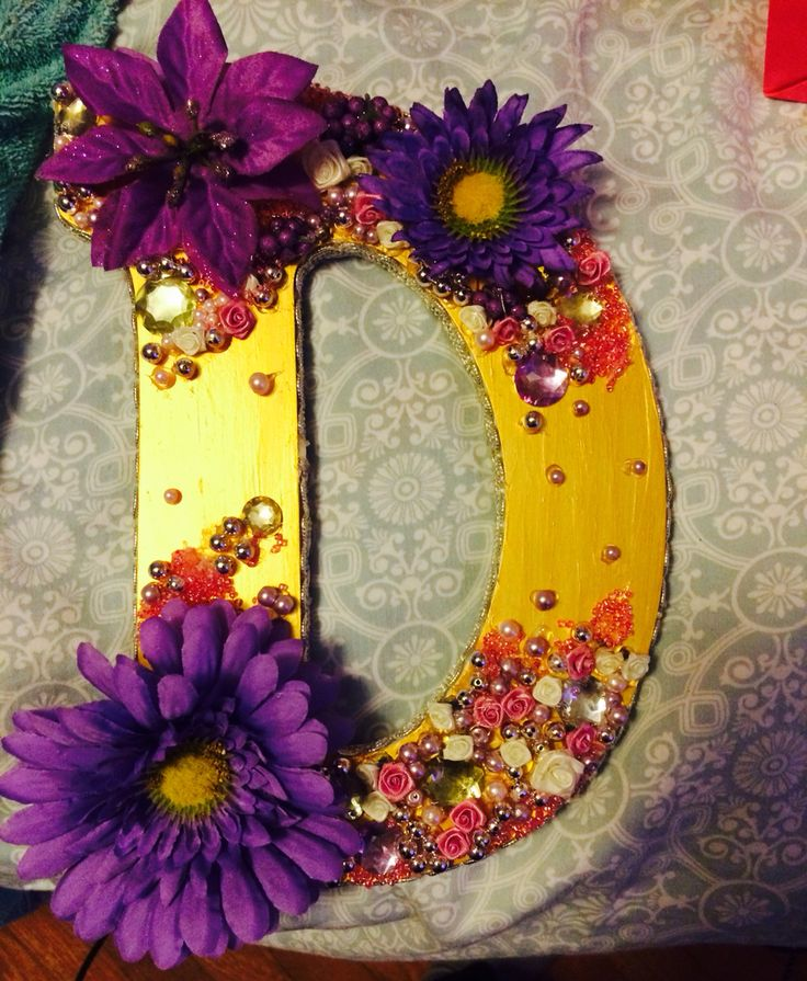 Wooden letter with flowers, rhinestones, and pearls
