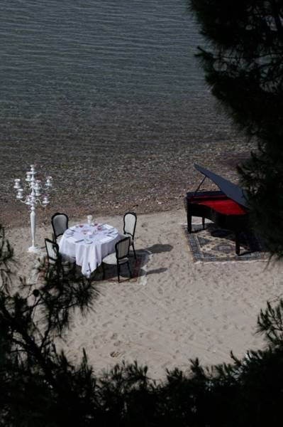 Enjoy a romantic dinner on the beach, while listening to the majestic sounds of the grand piano, at Danai Beach Resort & Villas, in Chalkidiki