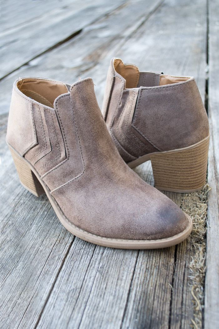 """Amazing ankle bootie heels for any dress or jeans. Super cute with a heel that measures 3"""" at the highest heel point. Slips on your foot and has a stiched desig"""