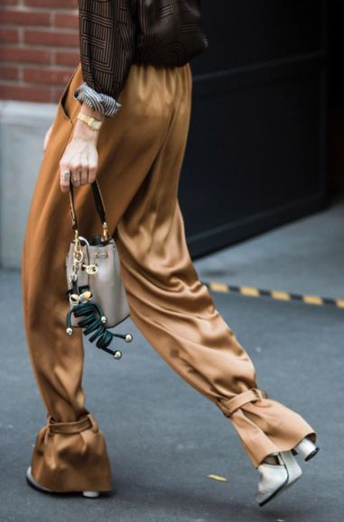 These quirkily gold satin pants with ankle ties are exactly the kind of vibrant clothing that embodies street style!