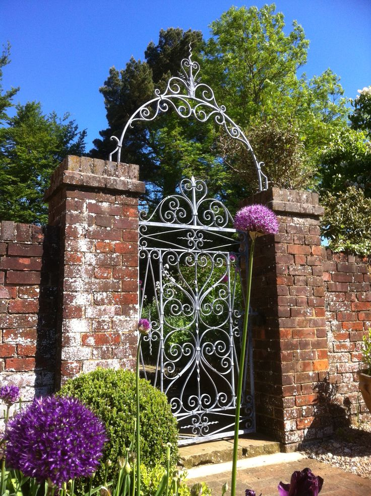 Traditional forge gate and arch