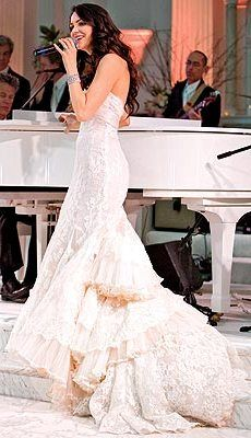 White lace gown with blush pink accents.