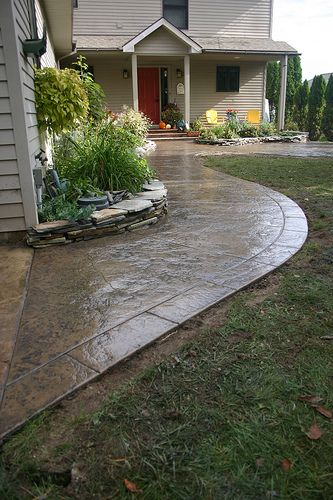 Seamless stamped concrete patio and sidewalk with segmented hand-tooled border - Pebble Davis Integral color with storm gray anti...