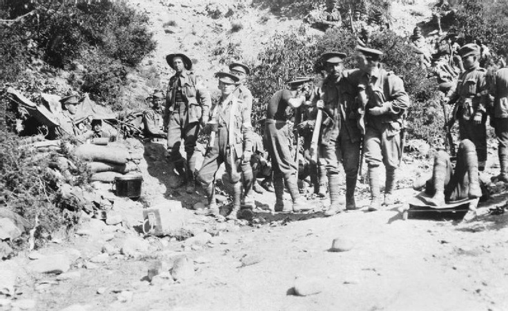 Wounded soldiers head for the Austrlian 3rd Battalion dressing station in Shrapnel Gully, Gallipoli, on 26 April 1915.
