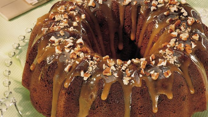 Caramel topping and nuts smother a rich chocolate cake.