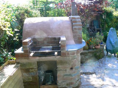 Build your own wood burning pizza oven - The only problem could be that once your family/neighbors/friends see it, they want one as well, and they might ask you to build one for them.