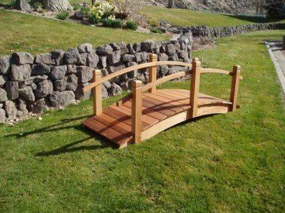 Wood Country 8 Foot Garden Bridge by Wood Country. $784.00. 8' Garden Bridge - Our wooden garden bridges will make a beautiful addition to any landscape setting. As a foot bridge over a creek or pond, a decorative accent in a large flower bed, they will create a functional and decorative architectural statement for years to come. They are weather resistant, strong, sturdy and handcrafted from all Western Red Cedar. All of our bridges come unstained without any st...