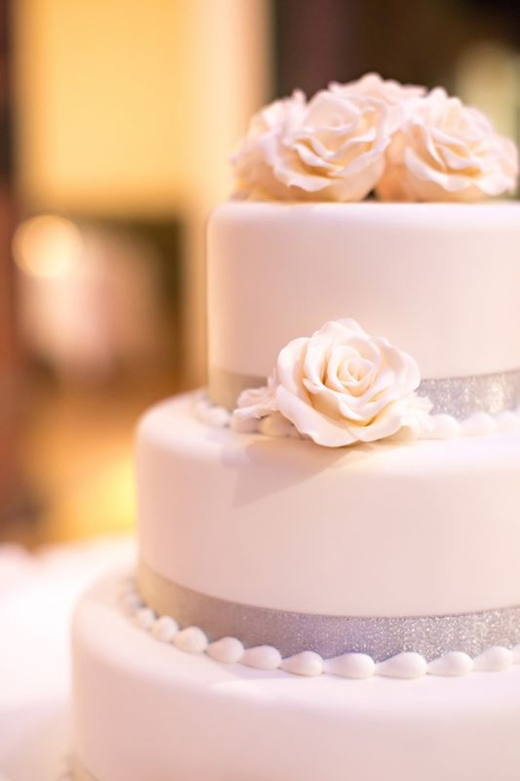 Wedding cake - like the icing beads next to the ribbon.