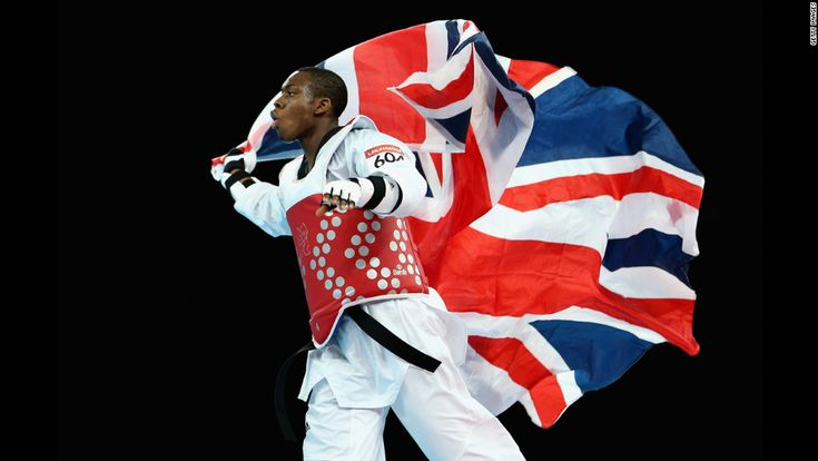 Lutalo Muhammad of Great Britian wins the bronze medal, tae kwon do
