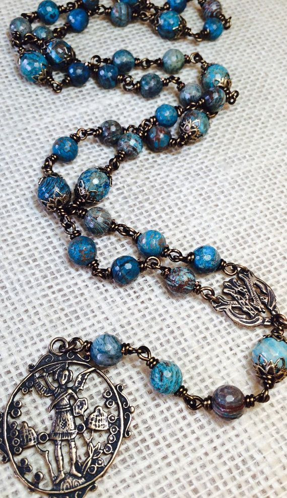 Large heirloom St. Michael bronze wire wrap chaplet with 10mm Turquoise Agate beads. This chaplet is shaped with 18 gauge wire. Each bead is hand turned with ornate caps to create a durable and attractive detail around each bead.  Vintage reproduction medals measure: St Michael is 2 5/8 Center is 3/4   The history of the Saint Michael Chaplet goes back to Antonia dAstonac, who had a vision of St. Michael. He told Antonia to pray nine salutations to the nine Choirs of Angels. St. Mic...