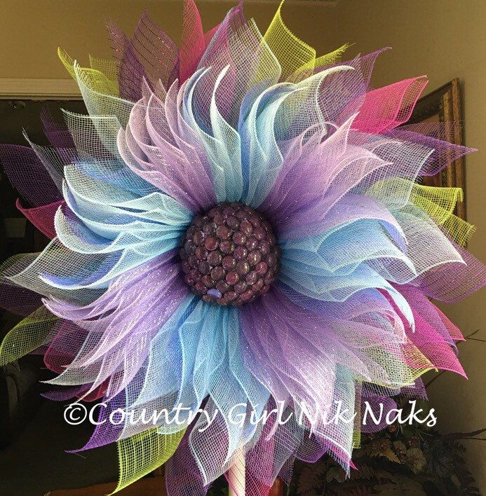 A personal favorite from my Etsy shop https://www.etsy.com/listing/475144517/deco-mesh-multi-colored-purple-blue