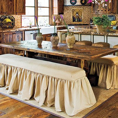 Table made from wood floor remnants AND LOVE THE COVERED BENCHES