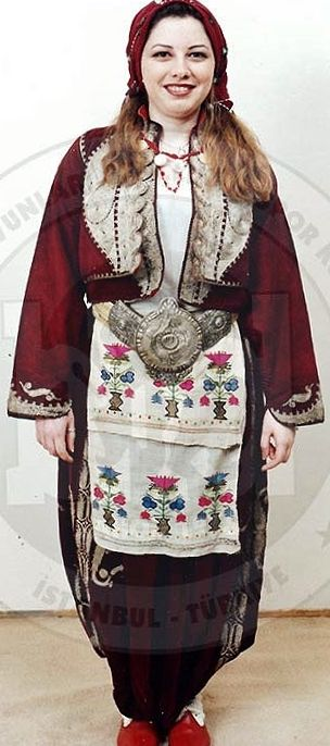 Traditional festive costume from Trakya/Thrace.  Turkish, c. 1925.  The velvet 'şalvar' (baggy trousers), 'yelek' (bodice) & 'cepken' (long-sleeved vest) are adorned with 'goldwork' embroidery in 'Rumeli' style.  (Costume Collection of the Bakırköy Halk Oyunları Derneği, Istanbul).
