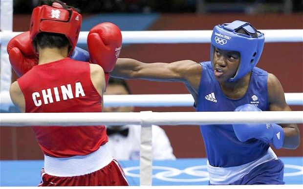 Great Britain's Nicola Adams won the gold medal with a brilliant performance in the flyweight final against her Chinese nemesis Ren CanCan, who had beaten her three months previously in the amateur world championship final. She becomes the first female boxer to win an olympic gold.