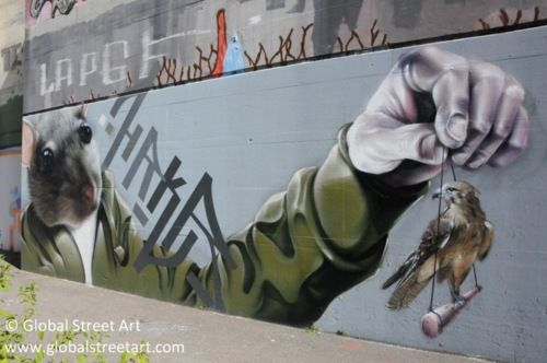 Photorealistic graffiti from Baden, Switzerland. By HRKR.