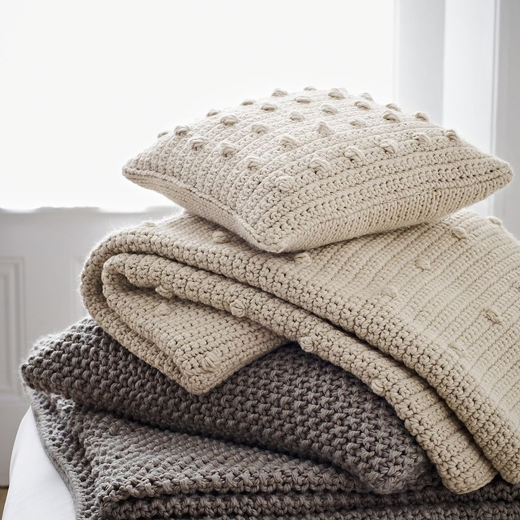 Love these knitted cushions and throws