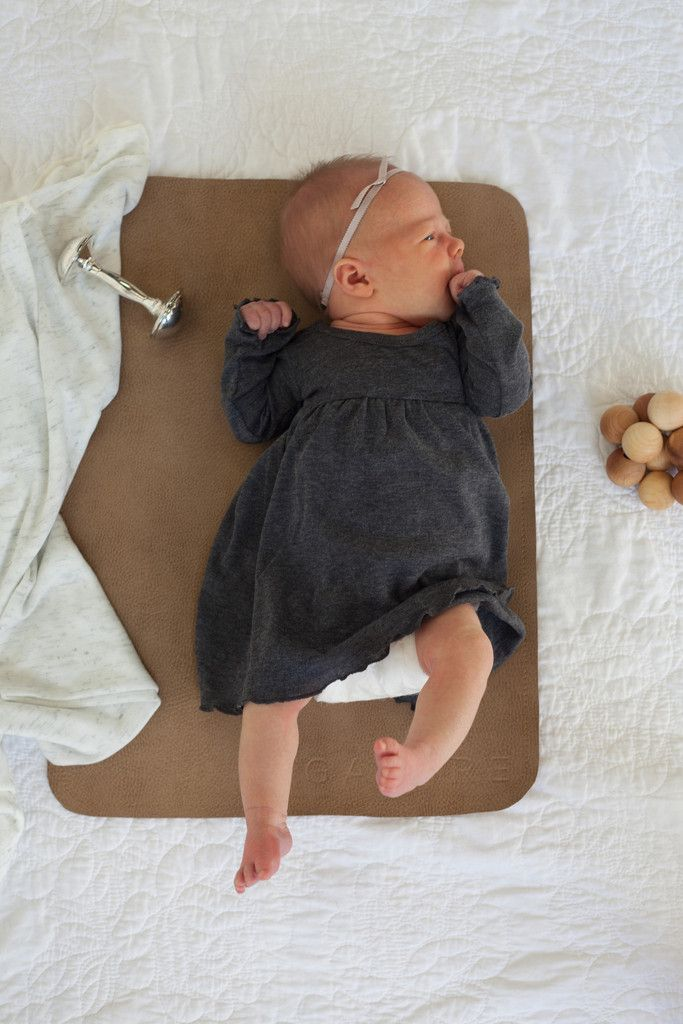 A little luxury diaper changing mat for the precious babies whose bottoms will soon be changed on them. Stores compactly in your bag, car, or home. Simply wipe spills off it's stain resistant surface