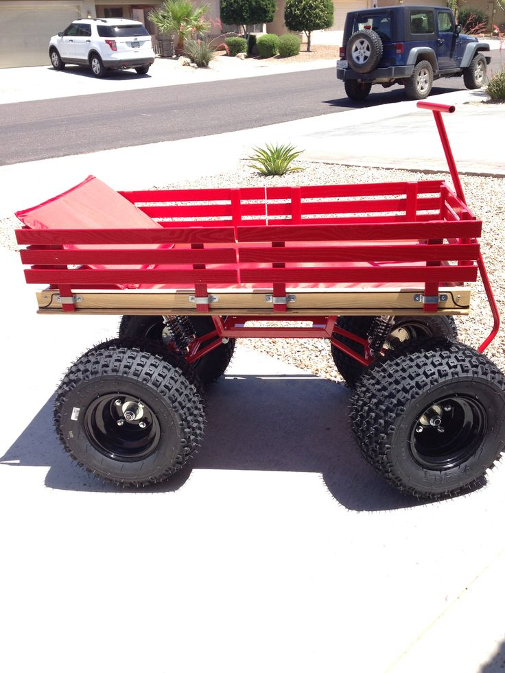 "Baja Wagon Swing-Arm Wagon with 18"" x 9.5"" knobby tires on black steel rims"