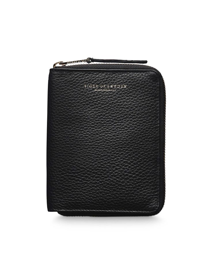 Madesimo wallet - Women's wallet in soft napa leather. All-round zip with leather strap on puller. Eight credit card slots. Embossed Tiger of Sweden logo. Size: 10.5 x 13.5 cm.