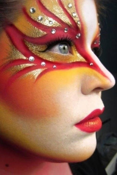 Create this vivid and bright Cirque du Soleil makeup look with this super easy video tutorial! With some bright paint, rhinestones, and metallic makeup, you can put together this DIY Halloween costume in no time!