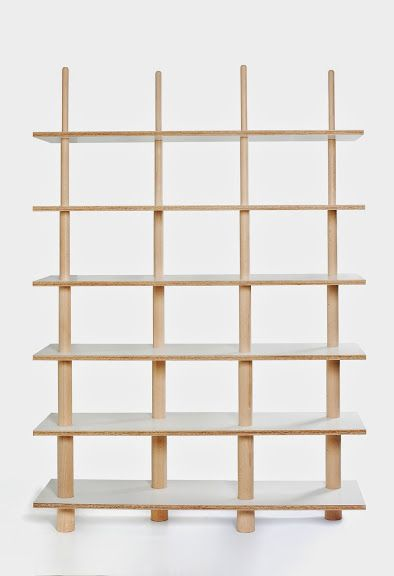 """""""Stick"""" is a bookcase based on a pole construction. This piece of furniture consists of shelves wedging on four wooden legs that narrow with stepped slopes. Each of the six shelves has 4 drilled holes of different diameter so that they block at a different height of a leg. The piece of furniture may function both as a wall bookshelf and an openwork partition that divides space."""