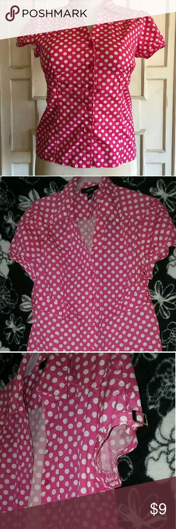 Pink with Polka Dots Short Sleeve Button Up Top. Pink with white polka dots. Fashion buckle on sleeves of shirt. Great Condition. Clean. Alfani Brand. Women's pink polka dot button down top in a size 8. Cute silver hardware detail at the sleeves. In excellent condition! No flaws. All measurements listed below are taken with the garment lying flat. Double measurements as needed.  Alfani Tops Button Down Shirts