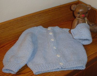 Free basic baby sweater knitting pattern with a crocheted button band for more stability
