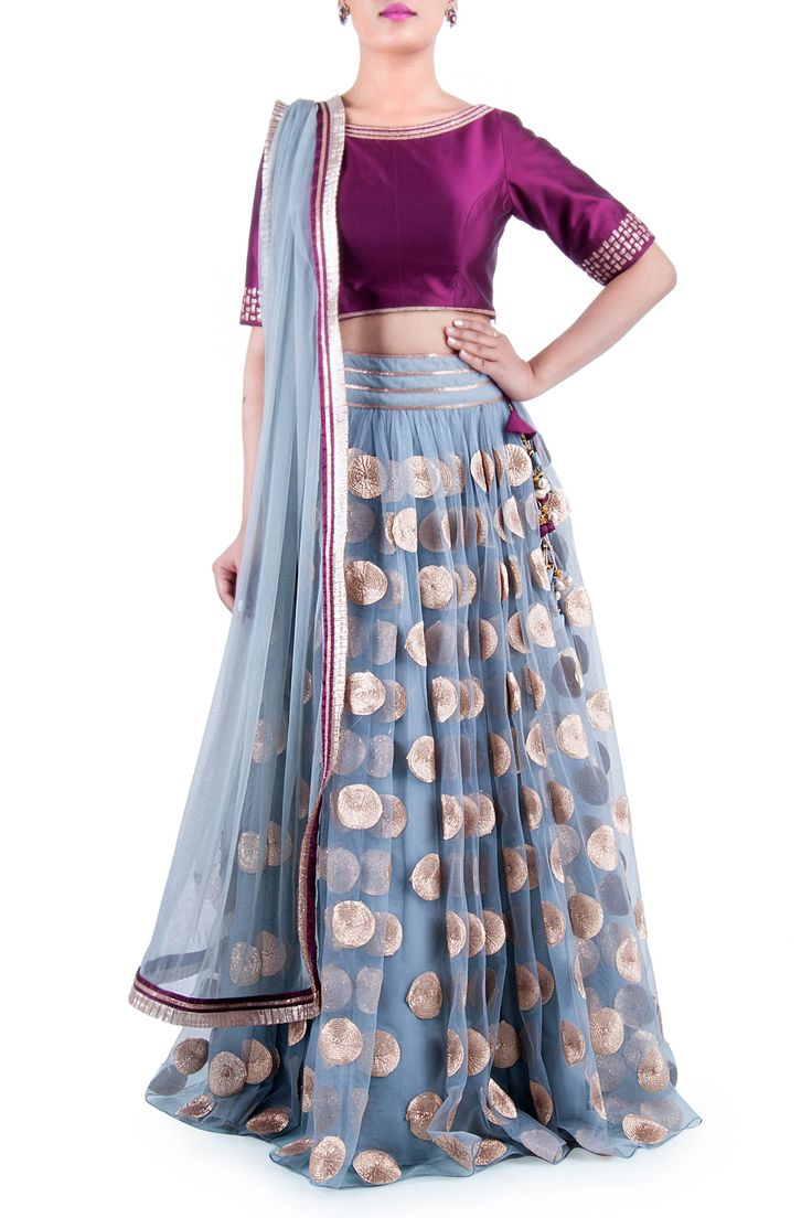 Net as a fabric much in trend. This grey net lehenga is beatified by gotta butti patterns making your attire class apart. Complimenting the attire is the net dupatta adorned with delicate pleated gotta border.