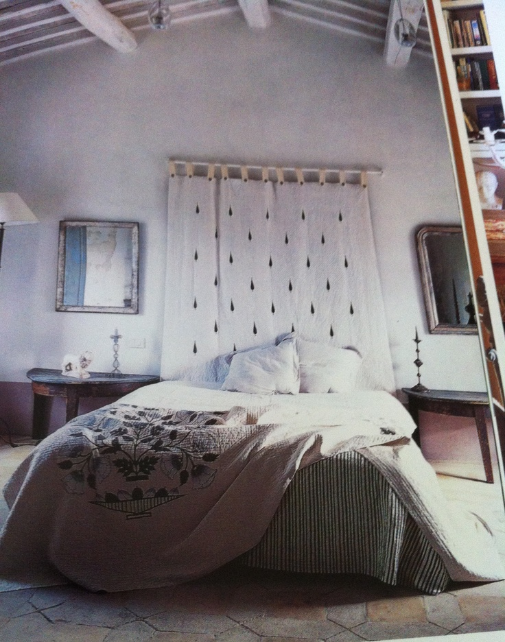 "'Italian Country Living"" by Caroline Clifton Mogg open to a bedroom with Brigitte Singh fabrics."