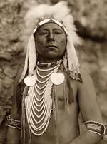Here for your enjoyment is an inspiring photograph of Which Way, a Crow Warrior. It was made in 1905 by Edward S. Curtis. / The photo illustrates a Crow Indian wearing a headdress and several necklaces. / We have compiled this collection of photos mainly to serve as a vital educational resource. Contact curator@old-picture.com. Image ID# 91B150AD http://www.old-picture.com/indians/Apache-Man.htm