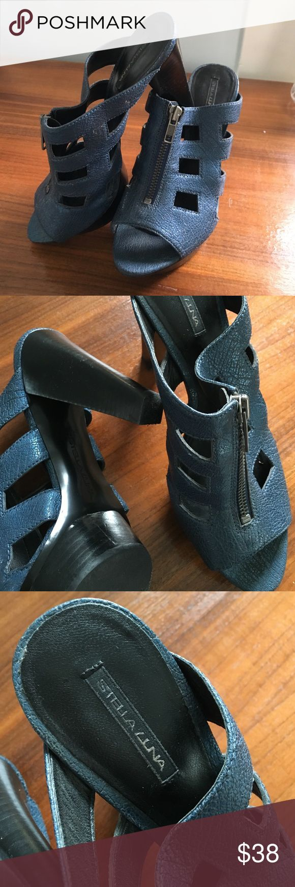 Stella Luna Blue Mules With an almost metallic finish, these mules have a zipper detail in the front that can be unzipped. Don't remember ever having worn them and heels and soles are pristine. Stella Luna Shoes Mules & Clogs