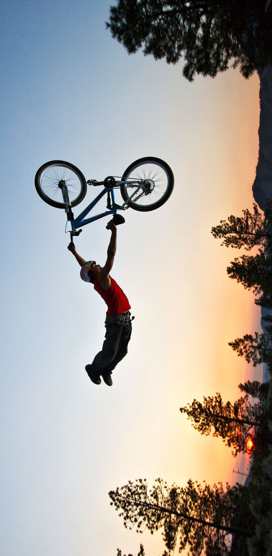 Superman MTB freerider Andreu Lacondeguy captured mid-trick in Kamloops, British Columbia, Canada.