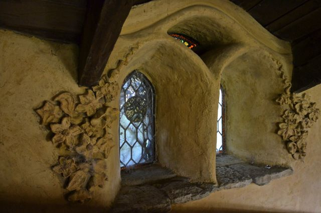 I like the flowers & stained glass. The Hobbit House, Chedglow