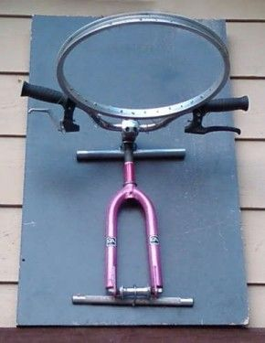Old Bicycle re purposed into a Basketball hoop.. cool!
