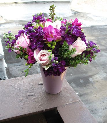 Pink Rosita Vendela roses, hot pink Freesia, and Subtle touches of Lavender roses and stock flowers make a peaceful & beautiful spring flower arrangement!