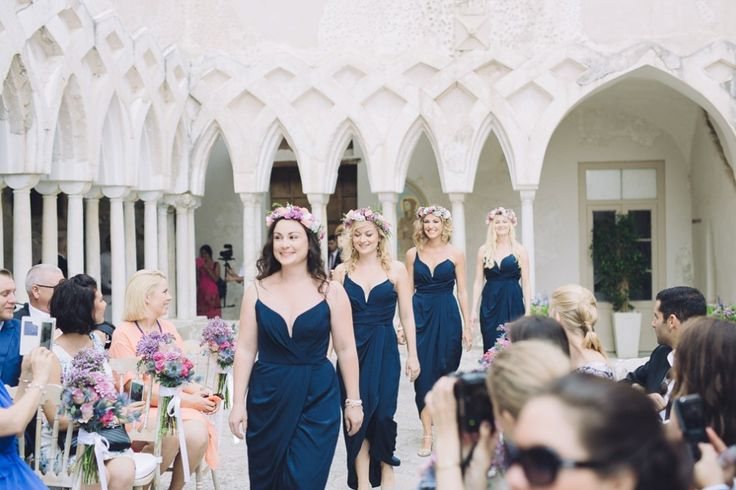 Bridesmaids wear navy blue dresses and flowercrowns | Planner and Designer http://www.sposiamovi.it | Photography by http://www.roncaglioneweddingphotographers.com/ #sposiamovi #amalfiwedding #weddinginitaly