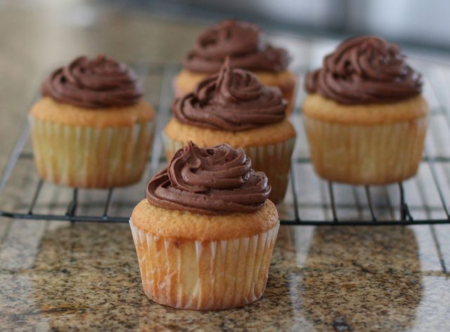 """Classic Vanilla Cupcakes with Chocolate Buttercream Frosting: Moist Vanilla Cupcakes ---- Here's a <b><a href=""""http://southernfood.about.com/od/Cakes-Pies-Desserts/ss/moist-vanilla-cupcakes-photo.htm"""">larger photo of these cupcakes</a></b>."""