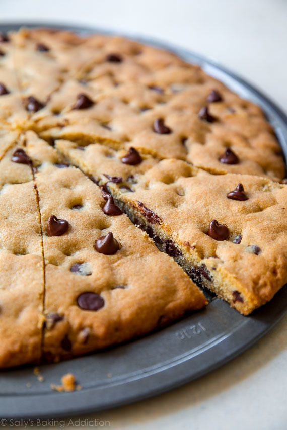 That easy recipe for classic chocolate chip cookie pizza! Makes a giant cookie pizza perfect for sharing. Recipe on sallysbakingaddiction.com