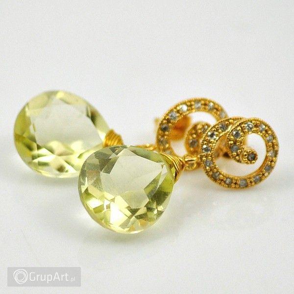 Ekskluzywne kolczyki wykonane z materiałów najwyższej jakości. Oprawa ze srebra pr999 i mosiądzu krytych złotem (16 i 24karatowym), eleganckie sztyfty zdobione cyrkoniami. Jako główna część kolczyka występuje okazała brioletta kwarcu lemon (15mm/12mm) wysokiej klasy AAA w szlifie diamentowym. #kolczyki #kwarc #srebro #bizuteria #grupart