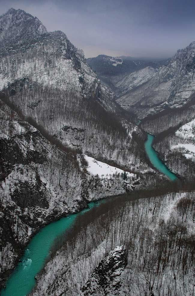 Tara Canyon , Montenegro-The Tara River cuts the Tara River Gorge, the longest canyon in Montenegro and Europe and second longest in the world after Grand Canyon, at 78 kilometers in length and 1,300 meters at its deepest.