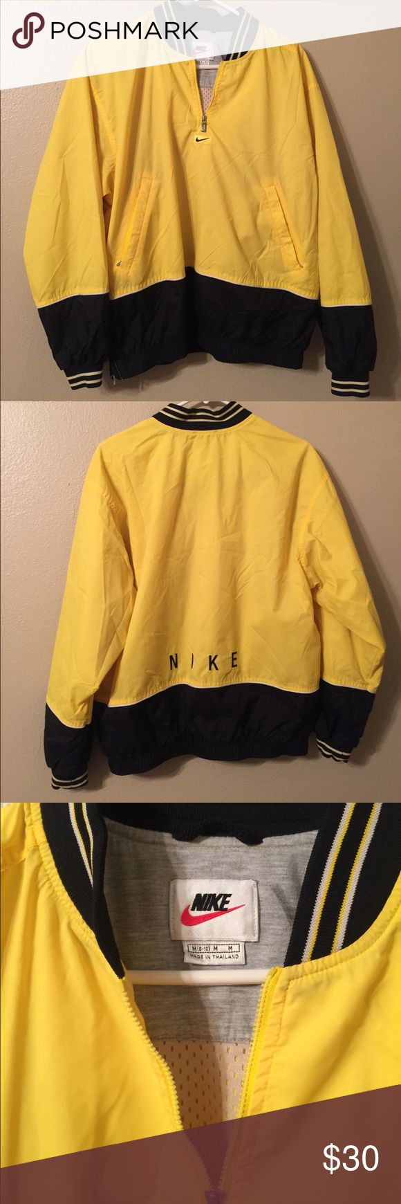 Vintage NIKE windbreaker pullover Mint Condition M Vintage NIKE windbreaker pullover mint condition. I can't find one flaw other than a few wrinkles. Black and yellow half zip jacket with Nike sign in front and NIKE logo on back. This is a women's medium. Bottom has a stretchy waist band that cinches so vey flattering not baggy, and side zipper as well. Inside mesh lining. Amazing 90's Nike windbreaker jacket. Price Firm, Ships next day  Nike Tops Sweatshirts & Hoodies