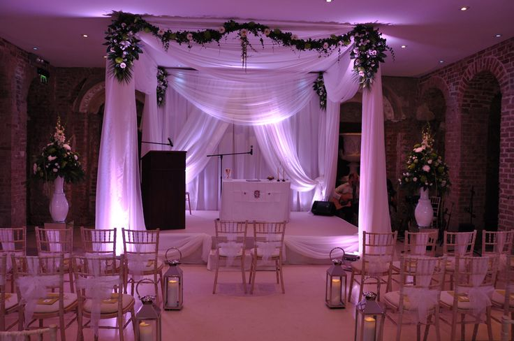 A Wedding Ceremony at Powerscourt House. Simply dressed Chiavari Chairs look great against the white draping.