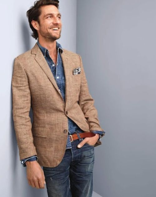 Shop this look for $228: http://lookastic.com/men/looks/denim-shirt-and-jeans-and-pocket-square-and-belt-and-blazer/615 — Navy Denim Shirt — Navy Jeans — White Floral Pocket Square — Brown Leather Belt — Tan Plaid Blazer