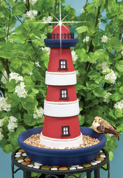 clay pots lighthouse how cute good idea for the garden next to the pool. Just add a solar yard light to the hole at the top, cheaper then running electric to it