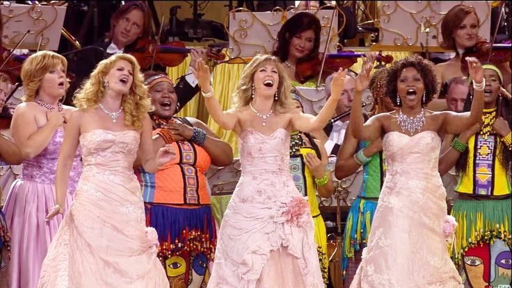 André Rieu and his Johann Strauss Orchestra performing 'I Will Follow Him' live in Maastricht.
