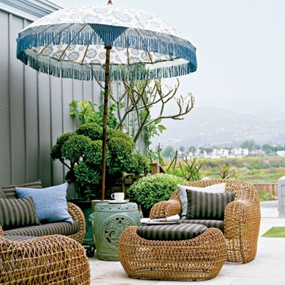 Porch/Patio: Bohemian Rhapsody   A batik-print umbrella and oversize woven furniture make a simple but stylish statement. A ceramic garden stool creates a space-saving side table on the petite patio