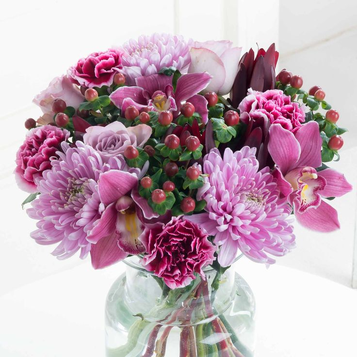 Enchanting Pinks: Soft, elegant and beautiful - this bouquet of enchanting blooms in pink and lilac tones is certain to bring delight to your loved one. A perfectly indulgent treat to celebrate any special occasion.