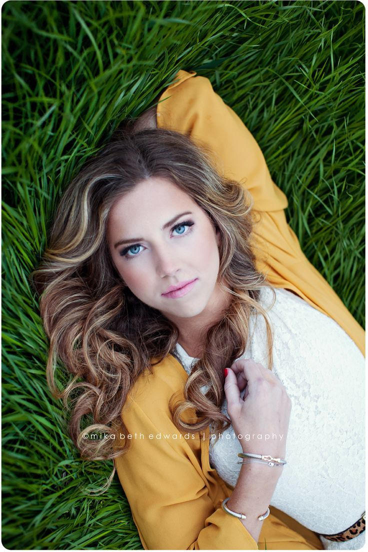 High School Senior Photography.  Like the color contrast with the grass.