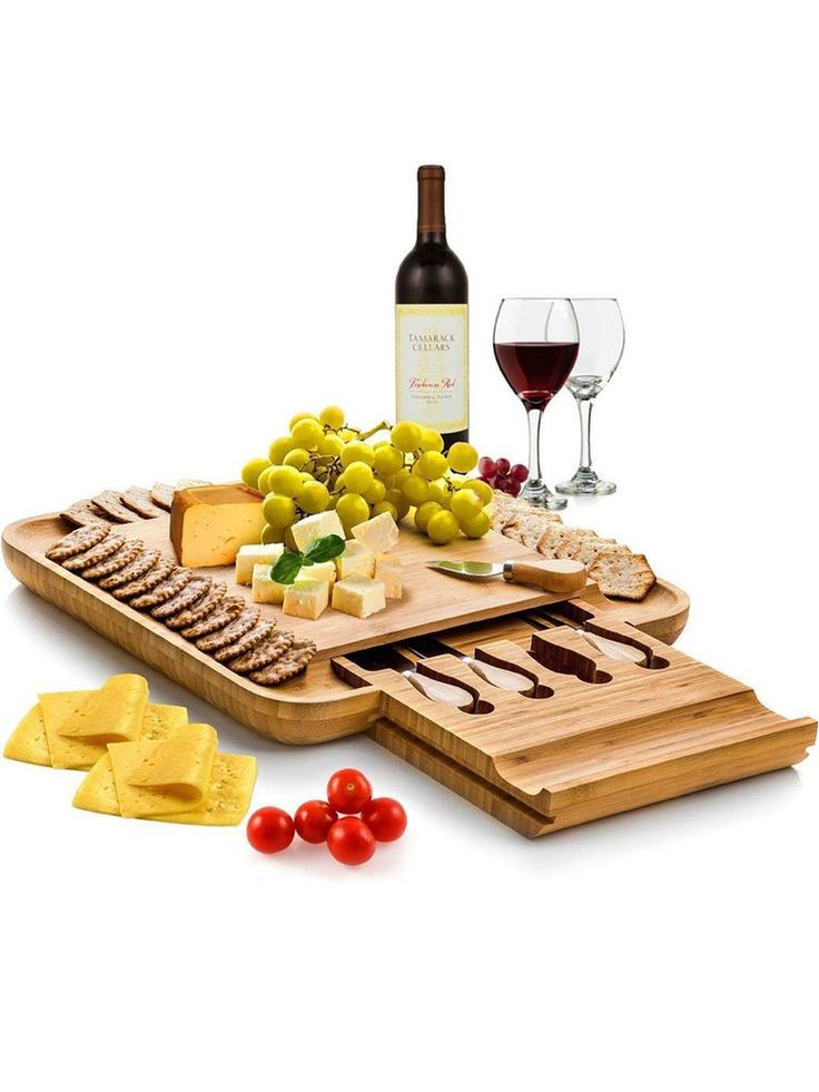 A cool twist on a classic wedding gift idea is the Bambüsi by Belmint, a bamboo cheese board and cutlery set.